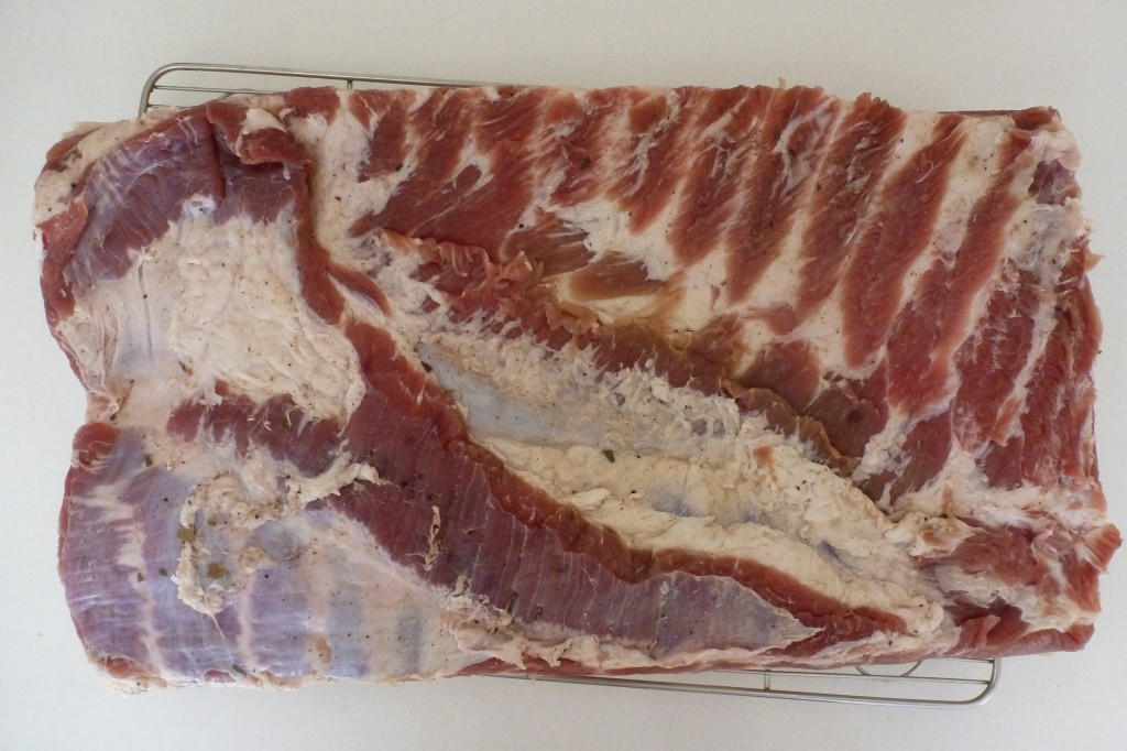 A cured slab of belly