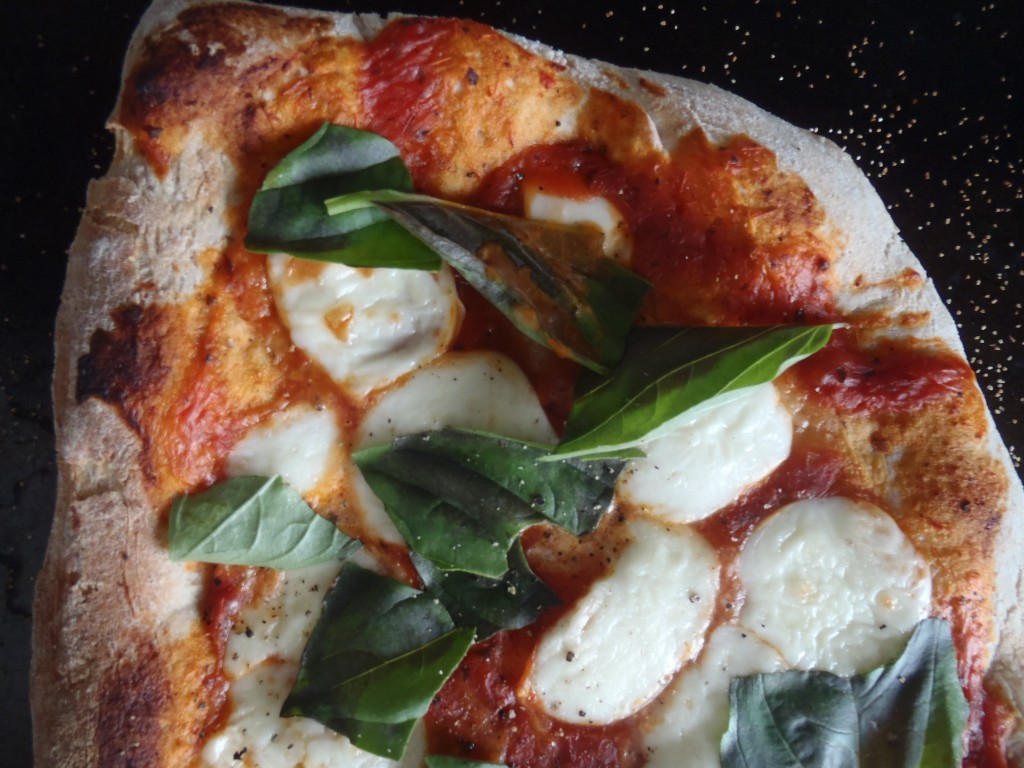 A margherita pizza with homemade mozzarella