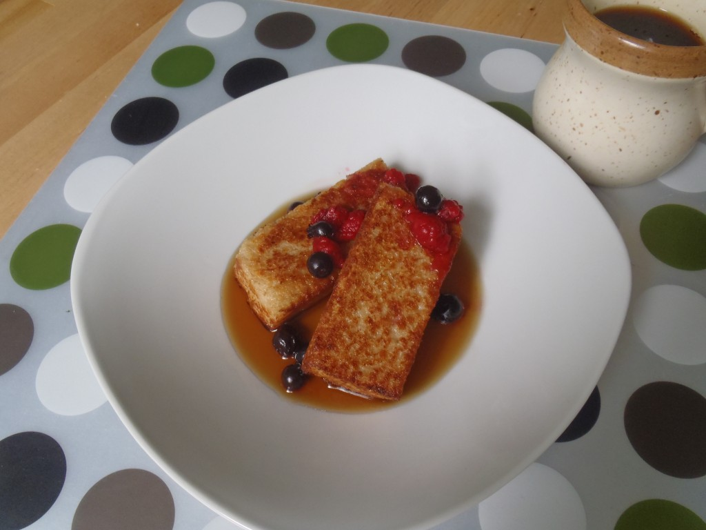 Fried porridge with berries and maple syrup