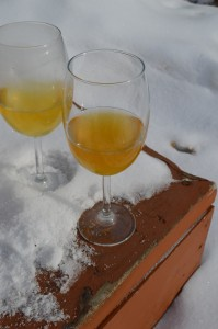 A glass of applejack beside a glass of cider: note the darker, bronze colour of the applejack