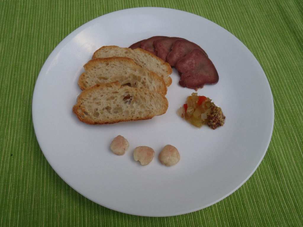 Charcuterie plate: toast, buffalo tongue, relish, and buffalo bone marrow