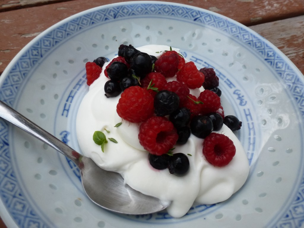 """Berries and Cream"": saskatoons, raspberries, whipped posset, basil, thyme"