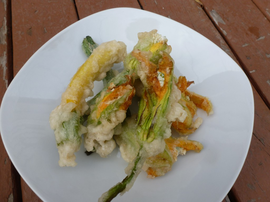 Squash blossoms, filled with cottage cheese and onions, battered and fried