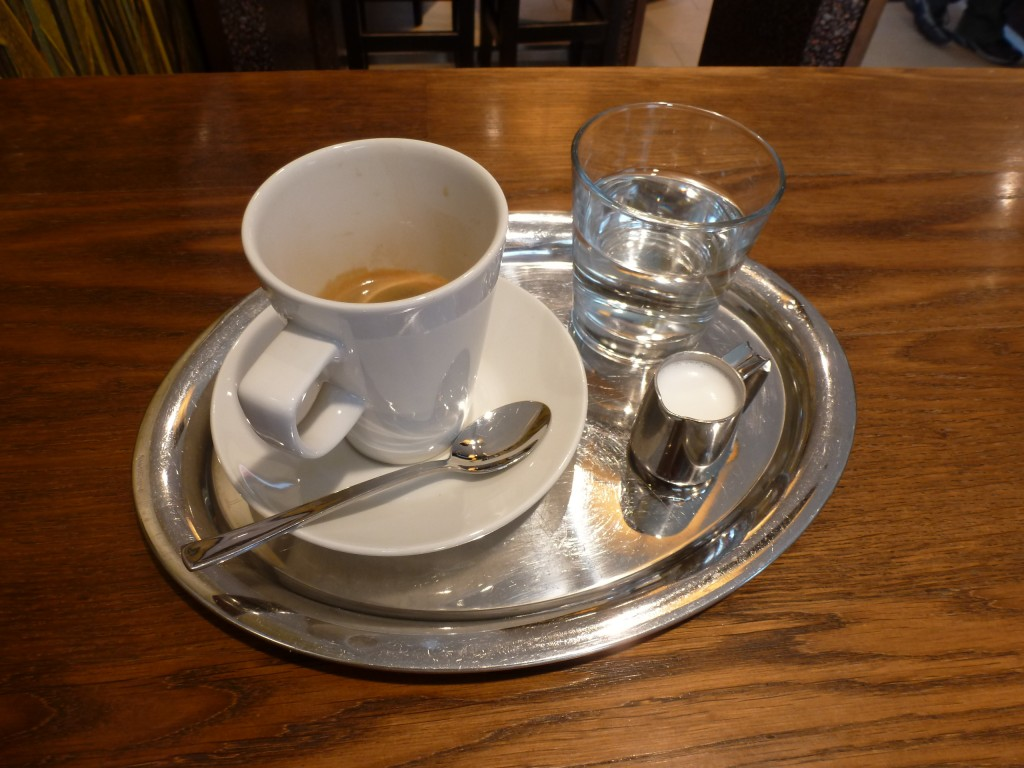 Traditional Viennese coffee service: silver tray, water, milk, and sometimes chocolate