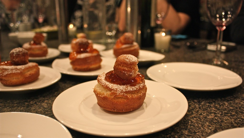 Raised doughnuts with rosehip jelly and powdered sugar