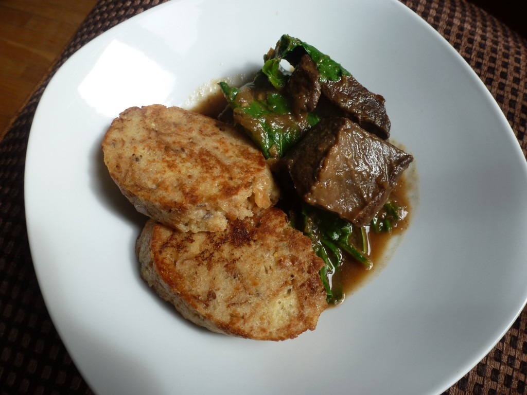 Braised beef heart, beet greens, and dumplings