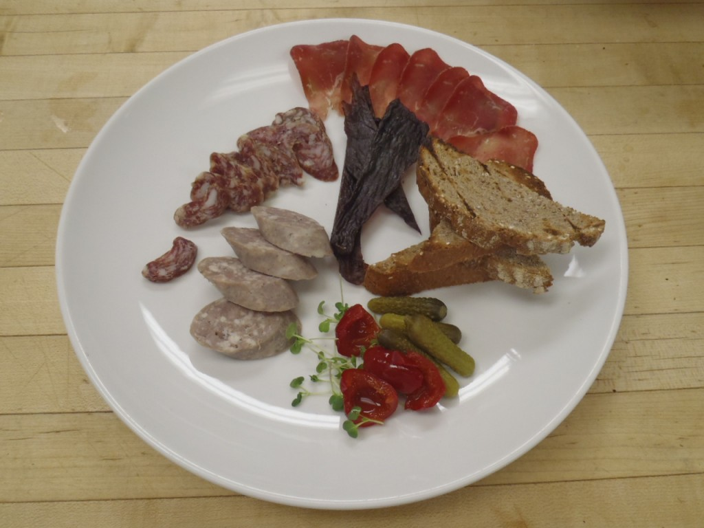 A charcuterie plate with air-dried beef in the top right.
