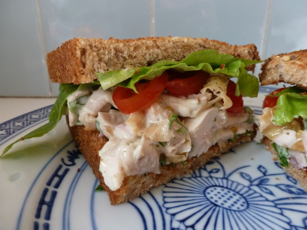 The finished chicken salad on toast, with tomatoes and lettuce