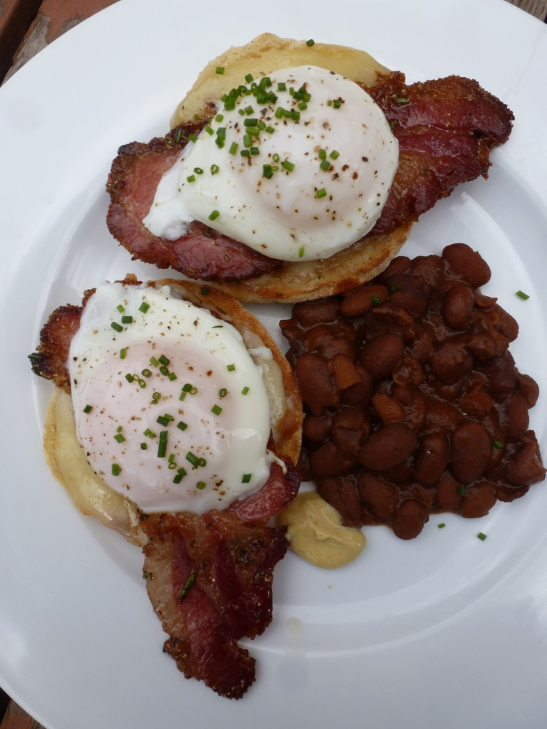 Eggs St. Lawrence: English muffin, cheddar, peameal bacon, poached eggs, brown beans.