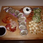 Seafood platter: cold poached lobster, Malpeque oysters, smoked salmon, crème fraîche with caviar, cucumber salad, pickled and devilled quail eggs