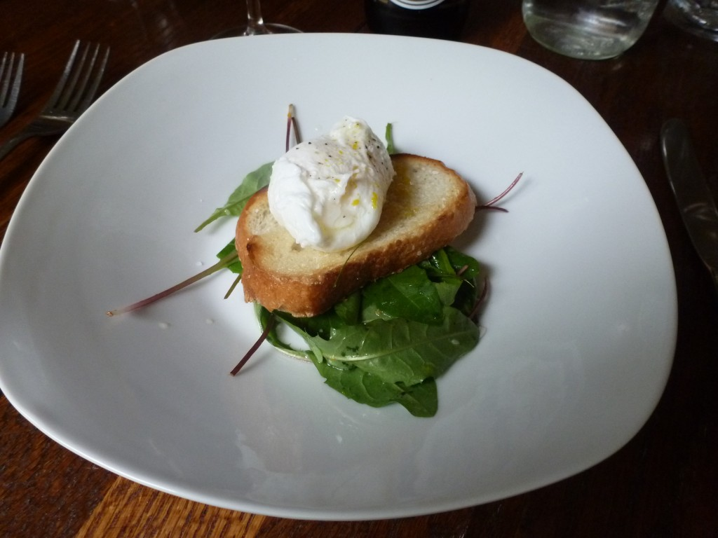 Dandelion greens, toasted baguette, and a poached egg