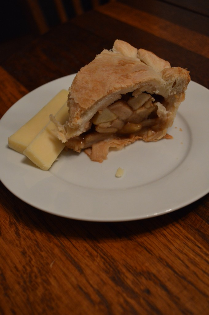 A slice of apple pie with Cheddar cheese