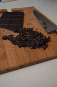 Chopping dark chocolate to make hot chocolate