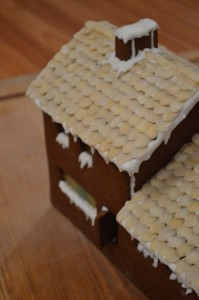 Royal icing used to mimic snow on a gingerbread house
