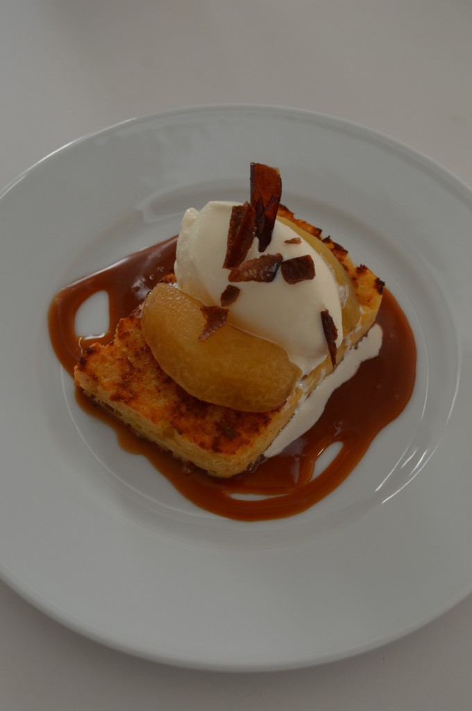 Cornbread pudding with poached apples, vanilla ice cream, and whisky caramel sauce