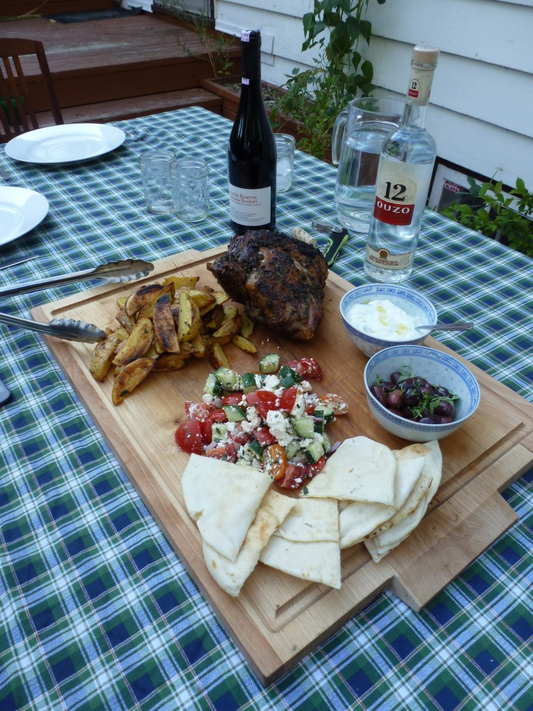 A Greek dinner for the August full moon: roast lamb shoulder, potatoes, olives, tzatziki, and horiatiki.