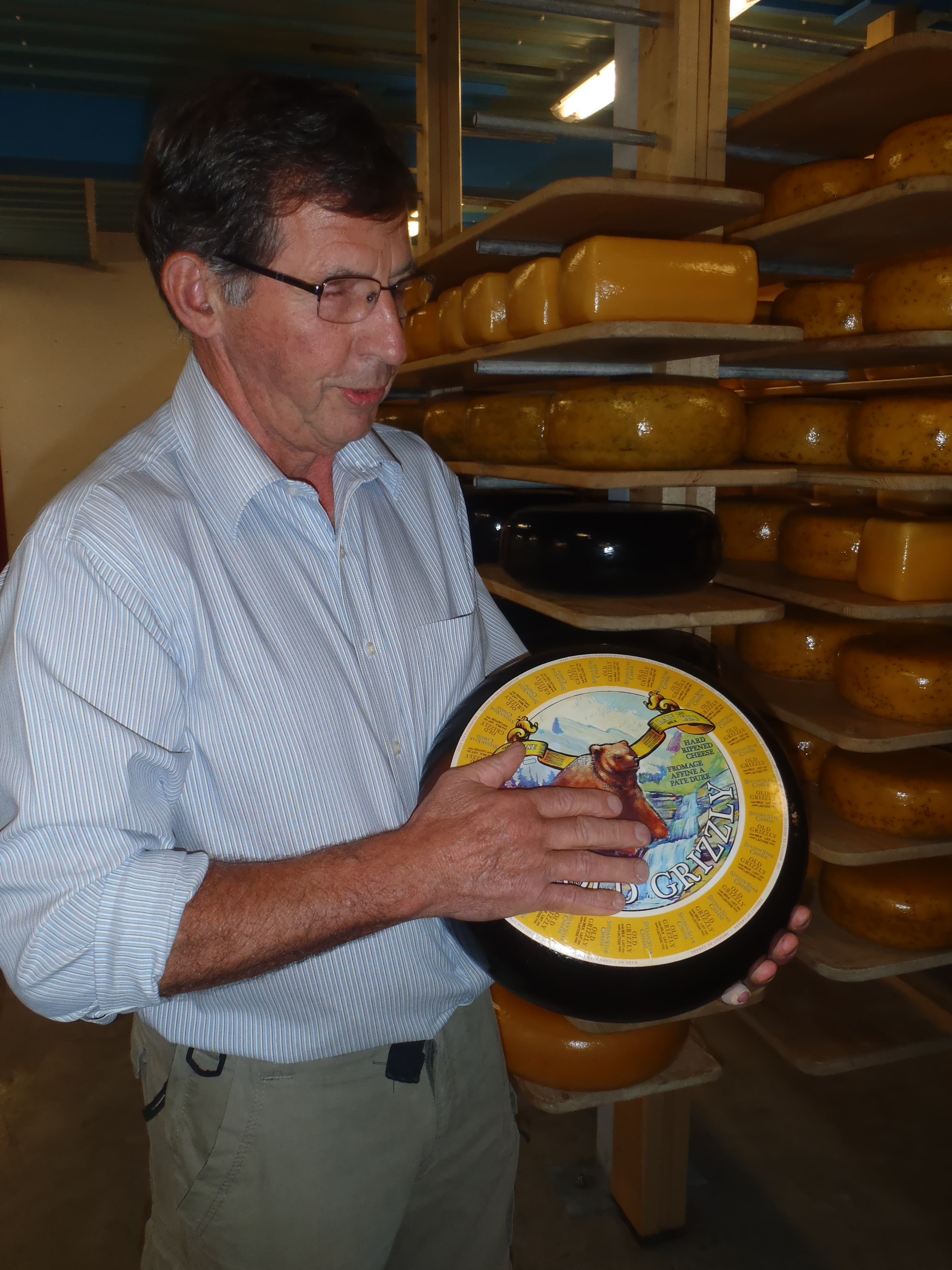 Sylvan Star owner Jan with a wheel of Grizzly aged gouda