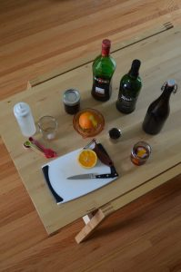 The ingredients and equipment needed to make an interesting twist on the classic Blood and Sand cocktail.