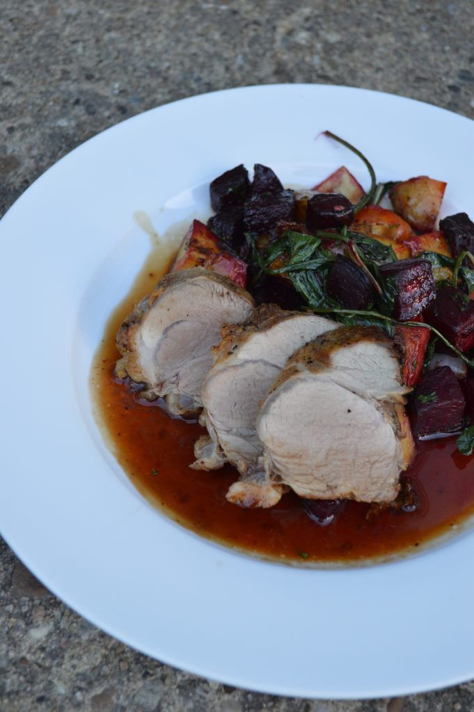 Roast pork, root vegetables, and an apple must pan sauce.