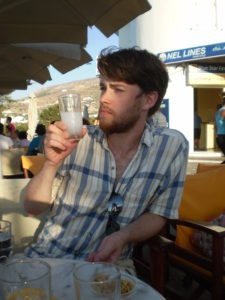 Me drinking a glass of ouzo with water in Parikia.