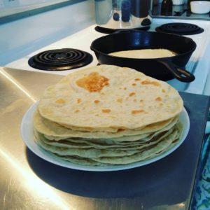 Homemade tortillas coming out of the skillet.