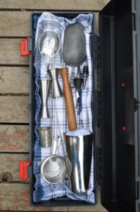 A bartender's took kit, with all the equipment required for making stirred and shaken cocktails.