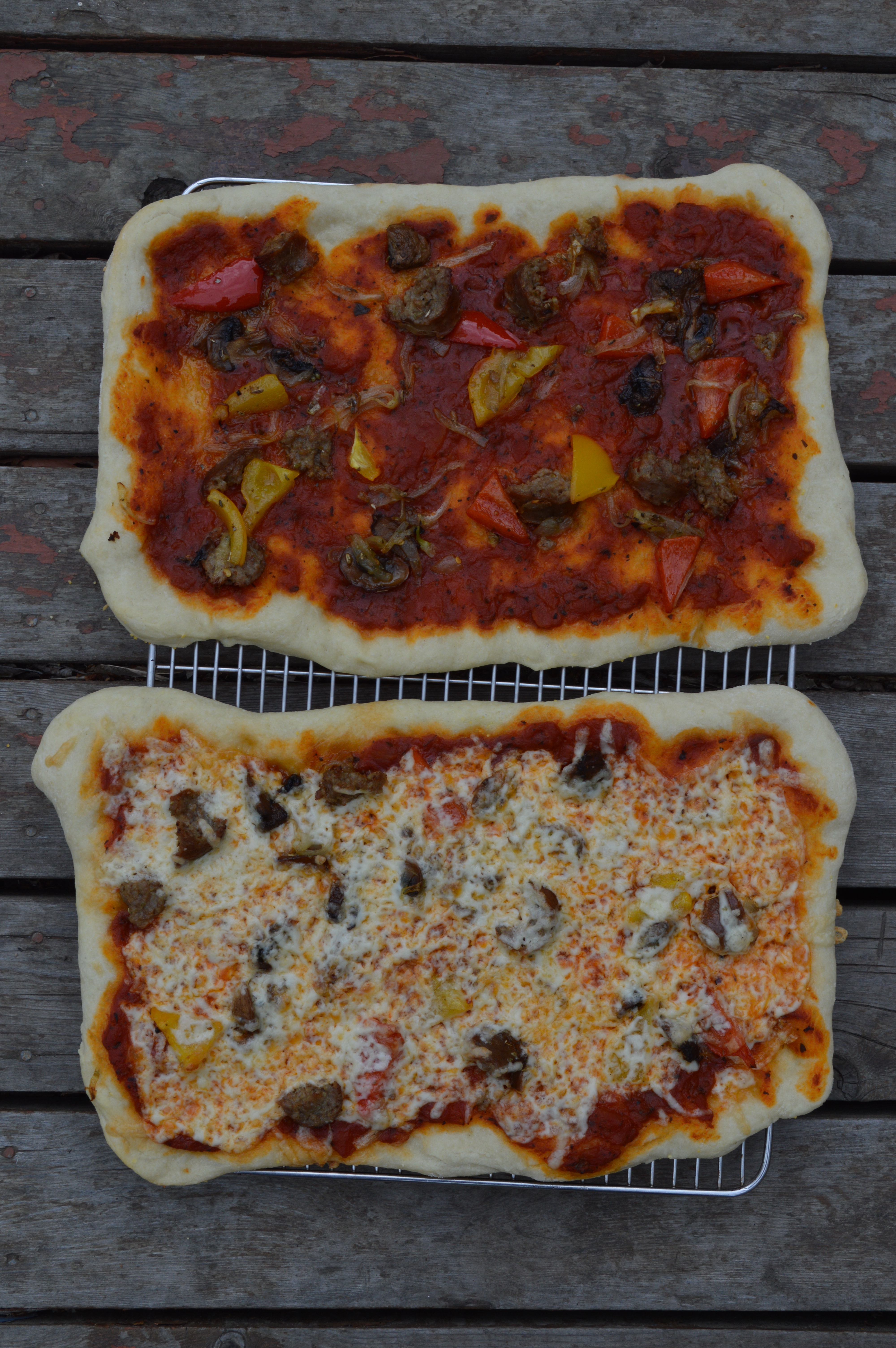 Homemade pizzas with sausage, peppers, and provolone.