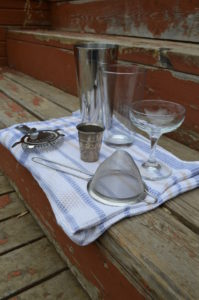 The equipment required for making a shaken cocktail: Boston shaker, Hawthorne strainer, and fine mesh strainer.