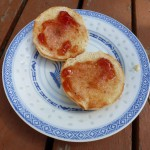 Toasted English muffins with butter and cranberry jelly