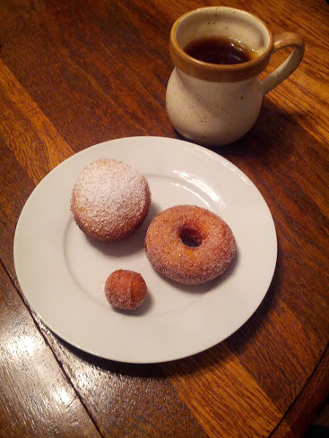Homemade doughnuts: jelly-filled, cinnamon sugar, and a doughnut hole