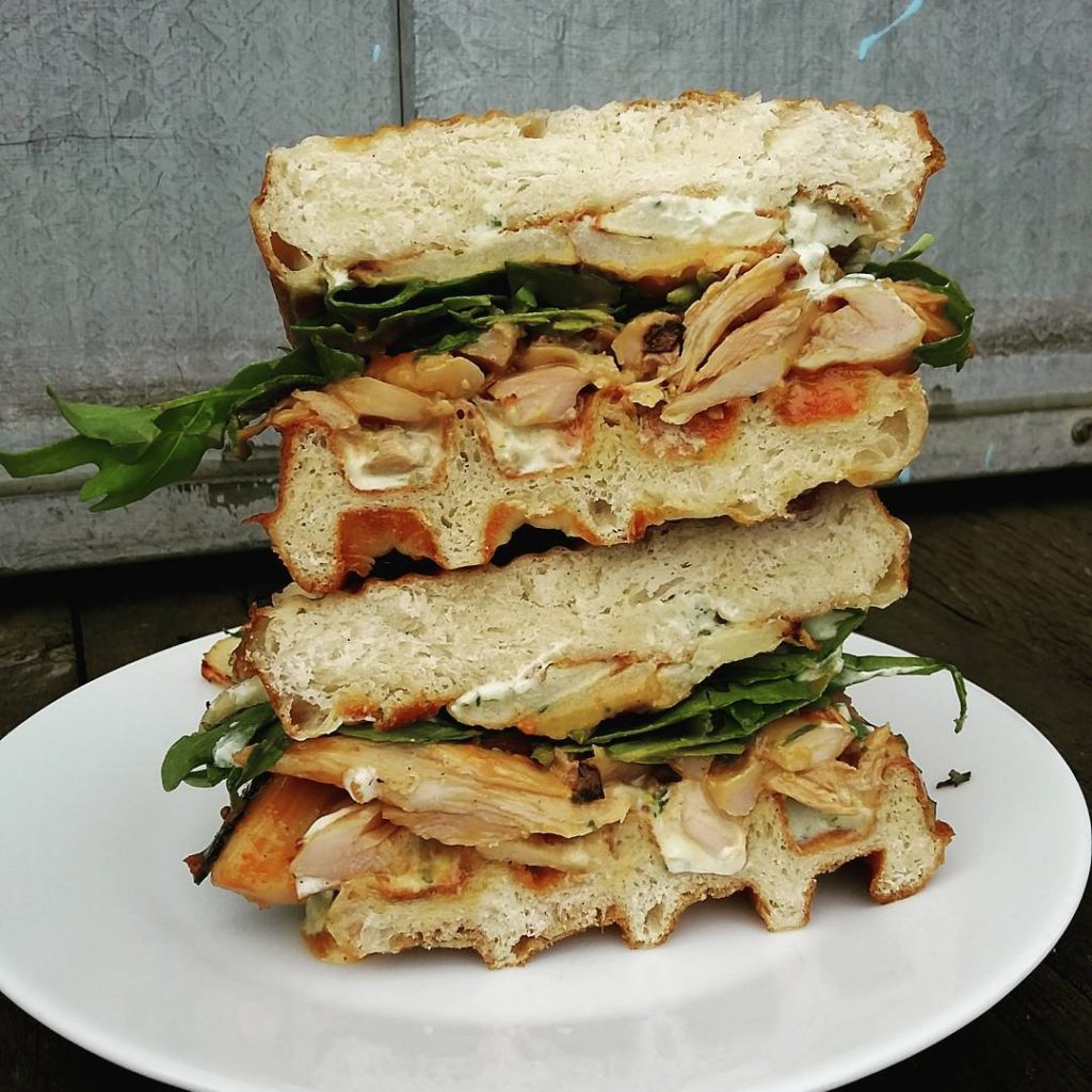 A chicken and waffle sandwich, with roast apple and goat's cheese