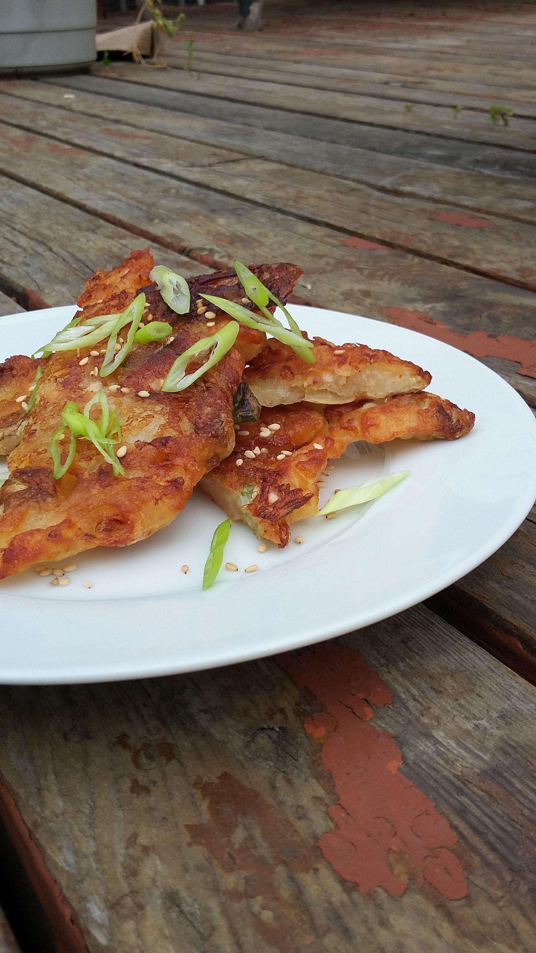 A plate of crispy kim chi pancakes