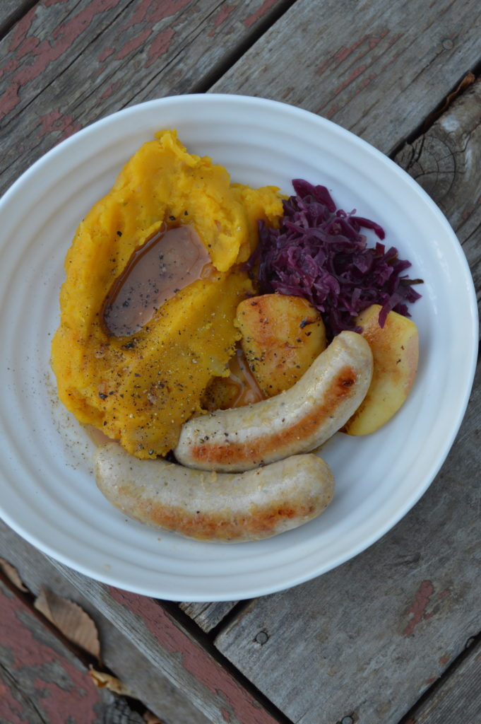 Homemade chicken sausage with mashed potato and squash
